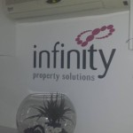 Infinity Property Solutions wall signage